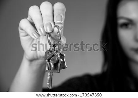 house keys by hand - stock photo
