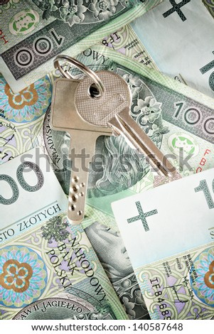 House keys on a background of banknotes - stock photo