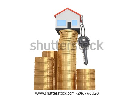 House keys on a gold coins stack on white background
