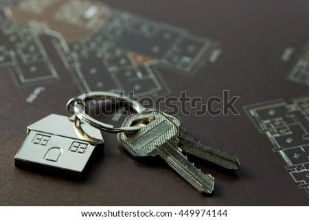 House keys on real estate floor plan - stock photo