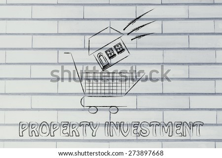 house launched inside shopping cart, concept of property investment - stock photo