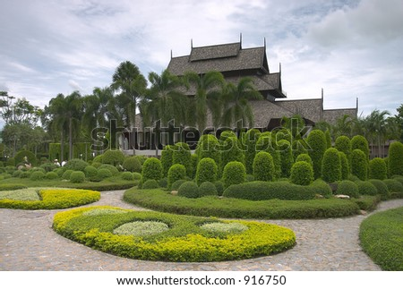 House, lawns and palms - stock photo