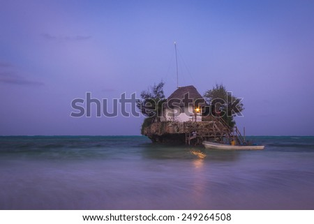 House located on a isolated rock at sea.  - stock photo