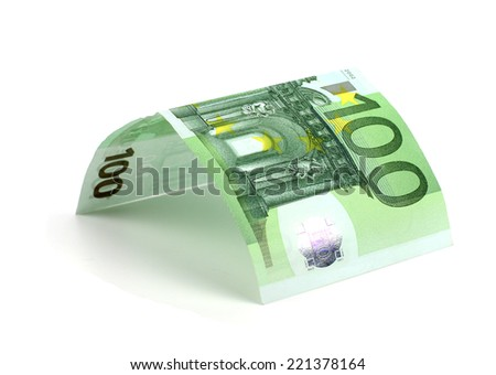 House made from euro bills isolated on white background - stock photo