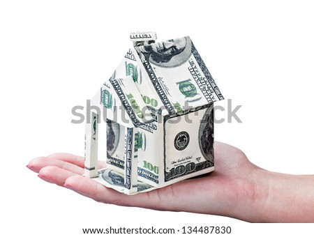 House made of money in hand isolated on white background - stock photo