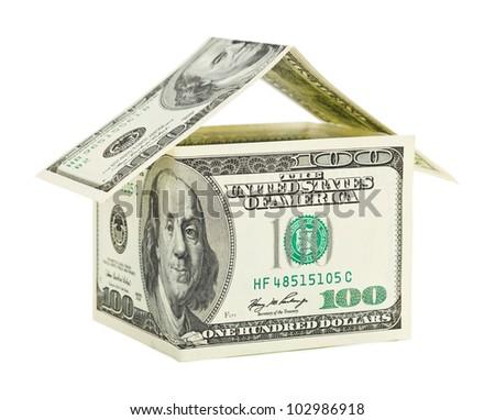 House made of money isolated on white background - stock photo