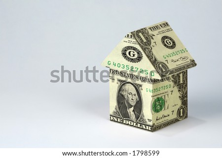 House made of money on light background