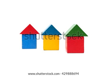 House made of old cubes. Wooden colorful building blocks isolated on white background. Vintage childrens toys.