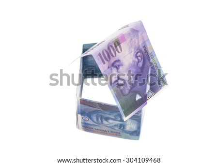 House Made of Swiss francs banknotes isolated on white.Currency of Switzerland - stock photo