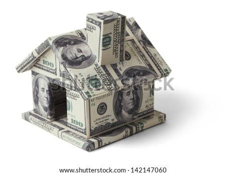 House made with Hundred Dollar Bills Isolated on White Background. - stock photo