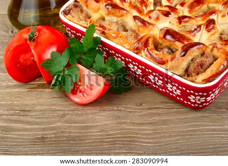 House meat pie and fresh vegetables on a wooden background.  - stock photo