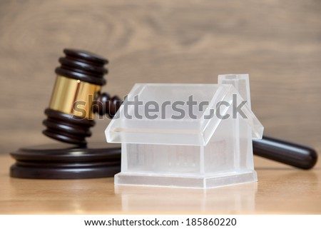 house model and a brown gavel - stock photo