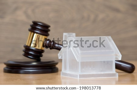house model and a brown gavel