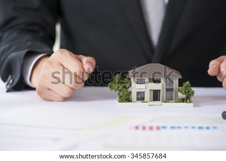 House model and businessman - stock photo