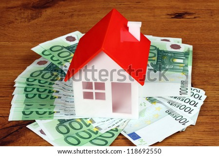 house model and money. Real property or insurance concept