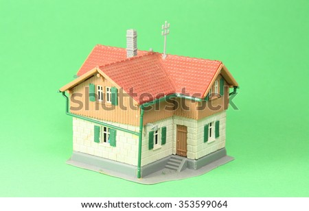 House, model house with a green background - stock photo