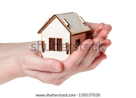 House model in both hands  isolated on white background - stock photo