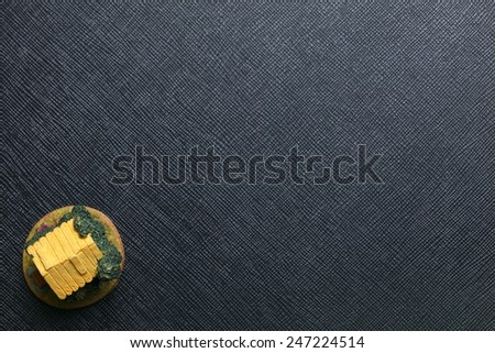 House model made from resin in the scene focus at the yellow color roof top view represent the house and construction concept idea. - stock photo