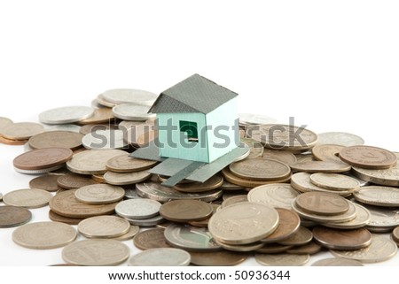 House model on coins - stock photo