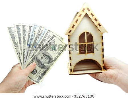house model on hand dollars cash money real estate concept                                - stock photo