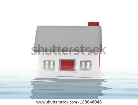 House model plastic submerged under water on white background - stock photo