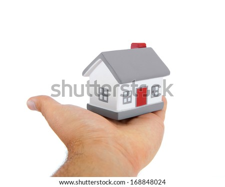 House model toy plastic in hand on white background - stock photo