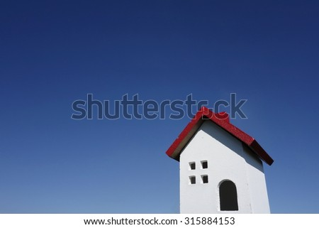 House model with blue sky