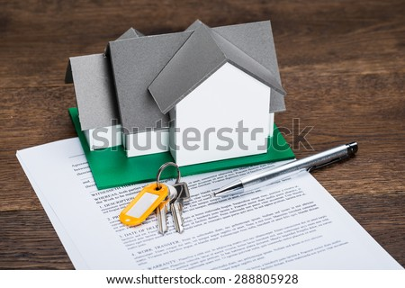 House Model With Keys And Ballpen On Contract Paper - stock photo