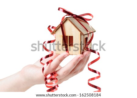 House model with ribbon in  hand  isolated on white background - stock photo