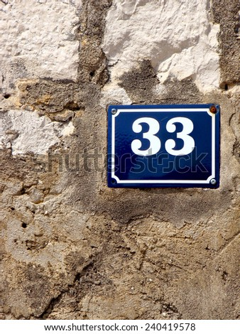 House Number 33 - stock photo