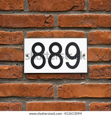 House number eight hundred and eighty nine. - stock photo