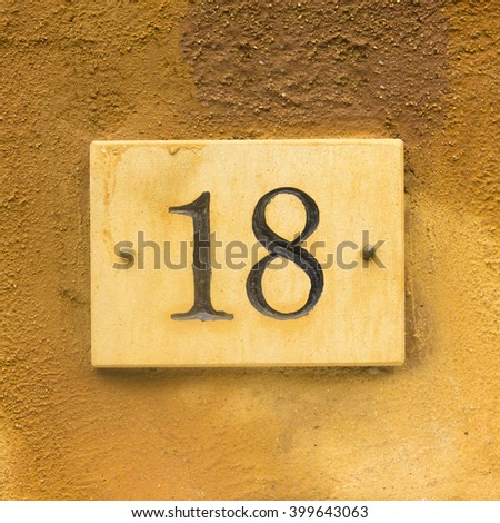 House number eighteen engraved in stone.