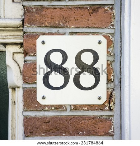 house number eighty eight , black numerals on a white background