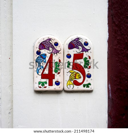 house number forty five on two separate ceramic tiles. - stock photo