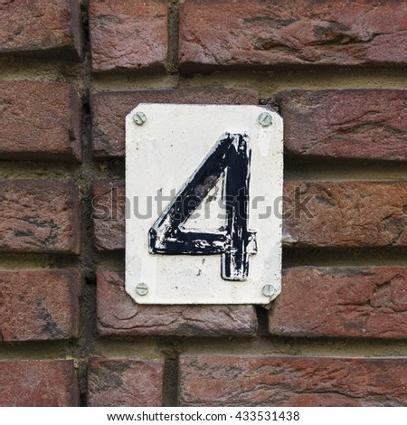 House number four embossed in a metal plate - stock photo