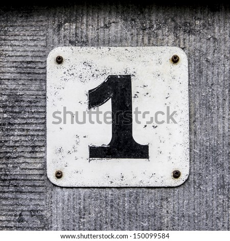 House number one . Black lettering on a white plate - stock photo