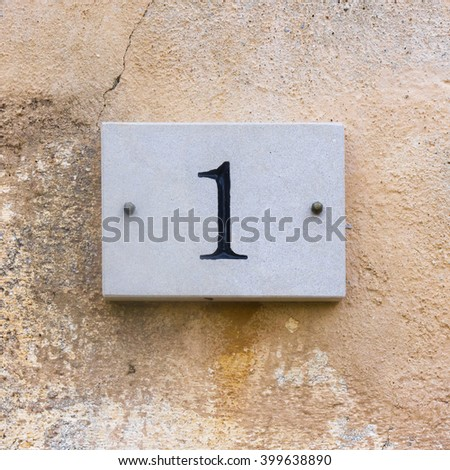 house number one engraved in natural stone - stock photo