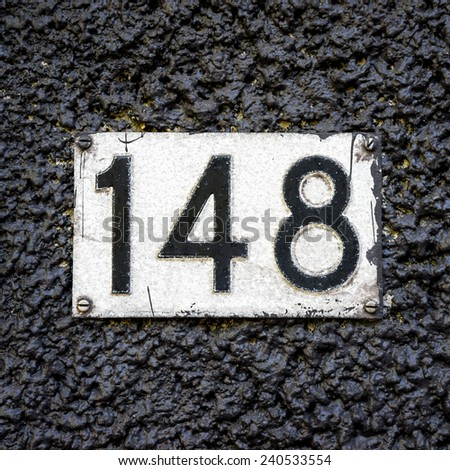 house number one hundred and forty eight - stock photo