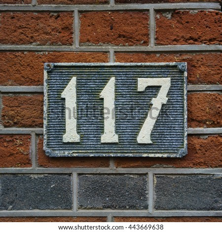 House number one hundred and seventeen - stock photo