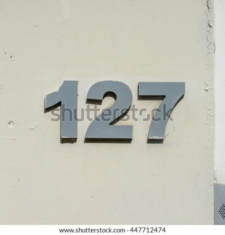 house number one hundred and twenty seven. - stock photo