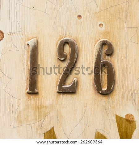 house number one hundred and twenty six, carved out of wood - stock photo