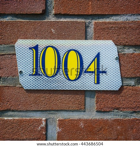 house number one thousand and four - stock photo