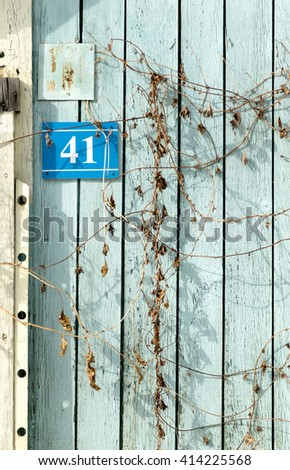 house number plaque with numbers - stock photo