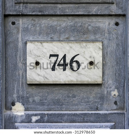 house number seven hundred and forty six, engraved in a marble plate - stock photo