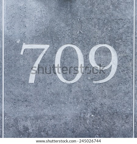 House number seven hundred and nine engraved in natural stone - stock photo