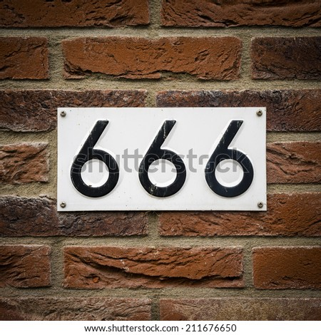 house number six hundred and sixty six embossed in a metal plate.  The number of the beast. - stock photo