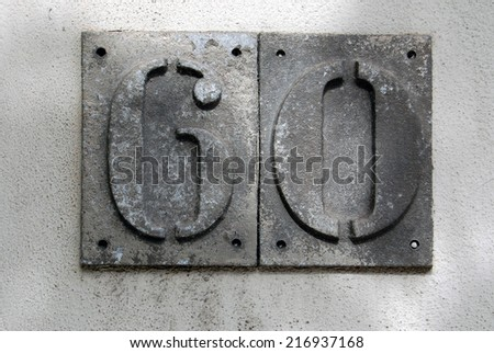 house number sixty - stock photo