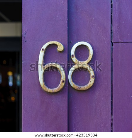 House number sixty eight - stock photo