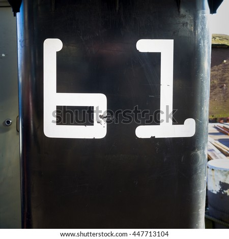 House number sixty one on a garbage can - stock photo