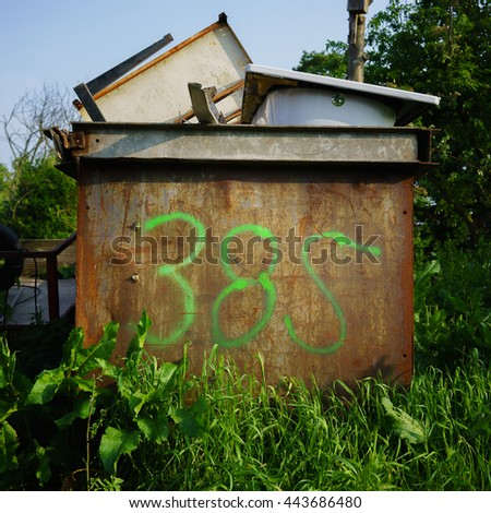 house number three hundred and eighty five, spray painted on a rusty container. - stock photo